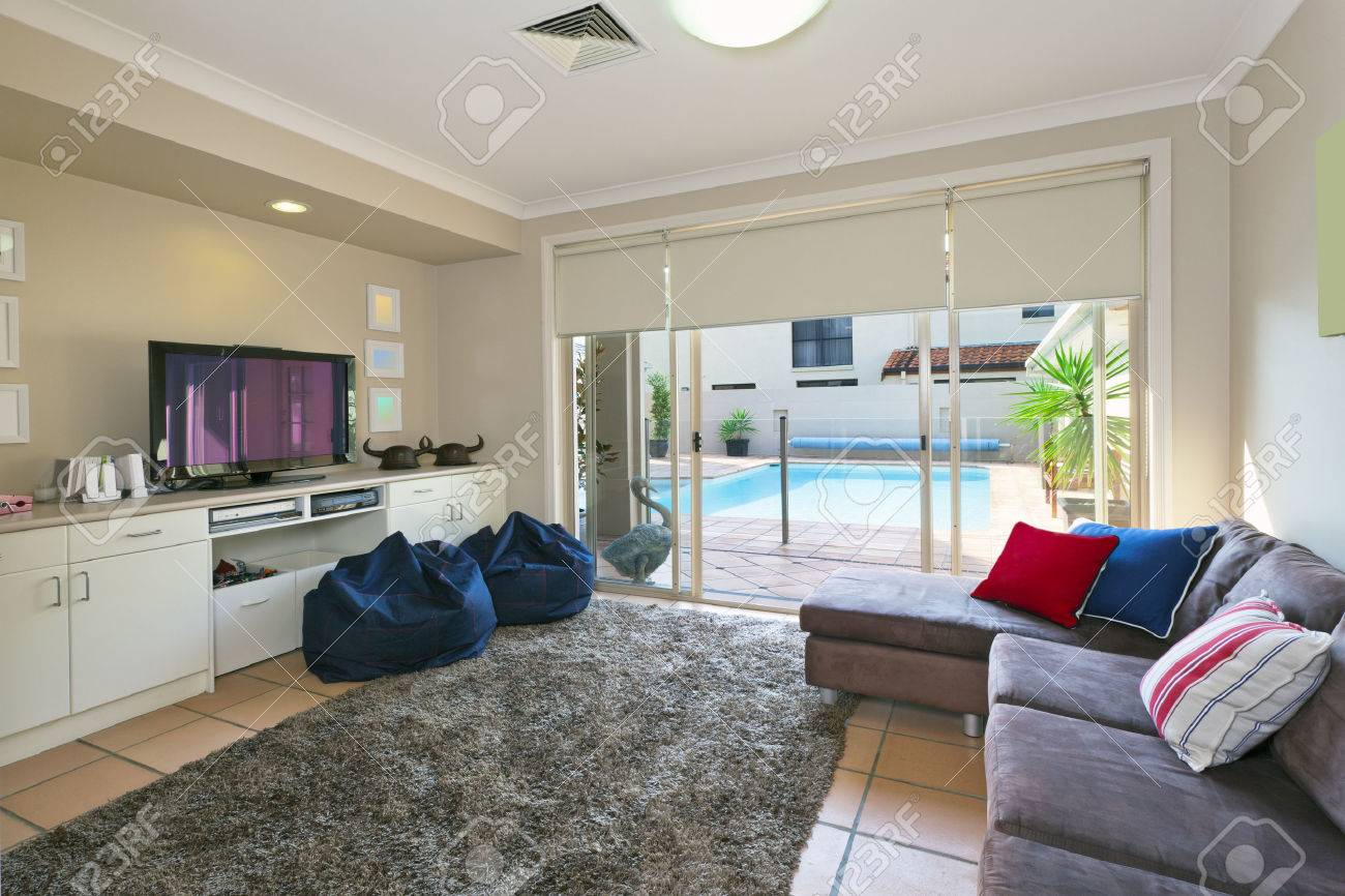 Uncategorized Modern Entertainment Room modern entertainment room which opens up to the backyard stock photo 25241388