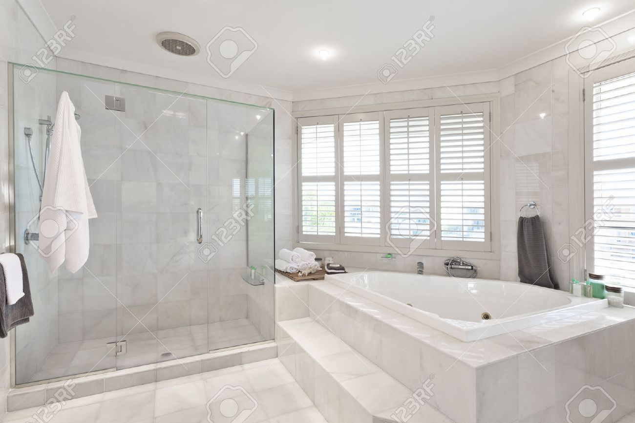 beautiful modern bathroom with marble tiles in australian mansion  - beautiful modern bathroom with marble tiles in australian mansion stockphoto