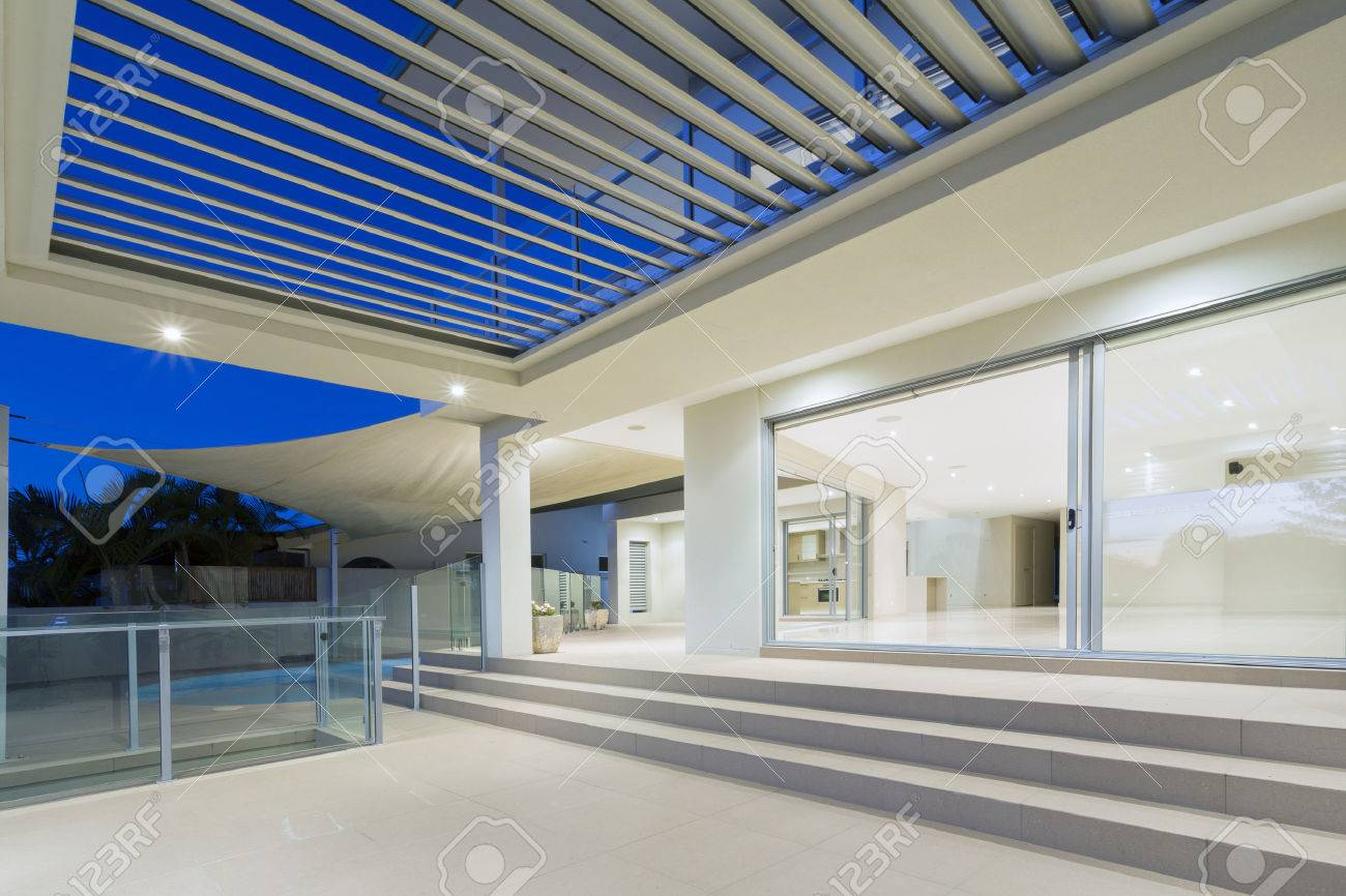 Stock photo white modern luxurious mansion exterior with deck and swimming pool on the gold coast queensland australia