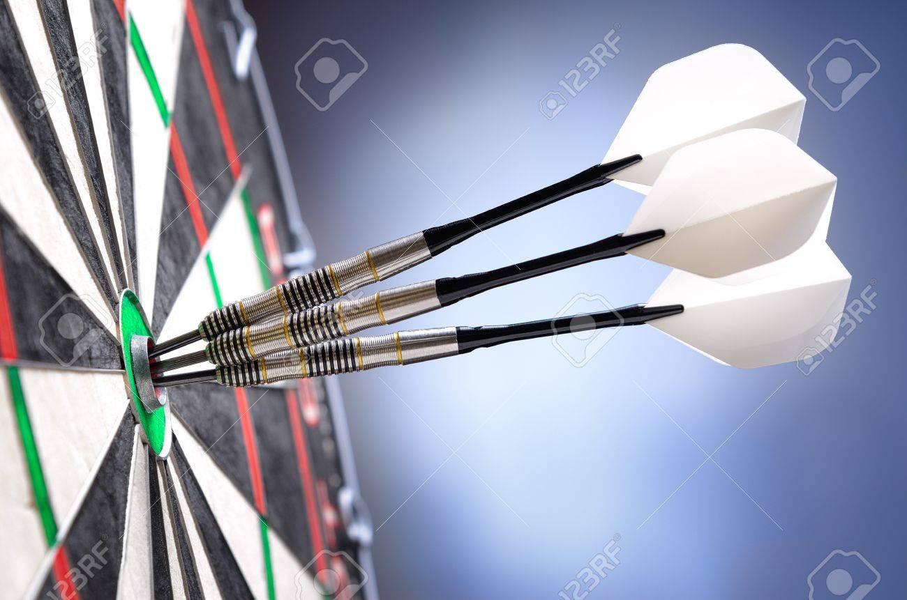 three darts in bullseye of dartboard stock photo picture and