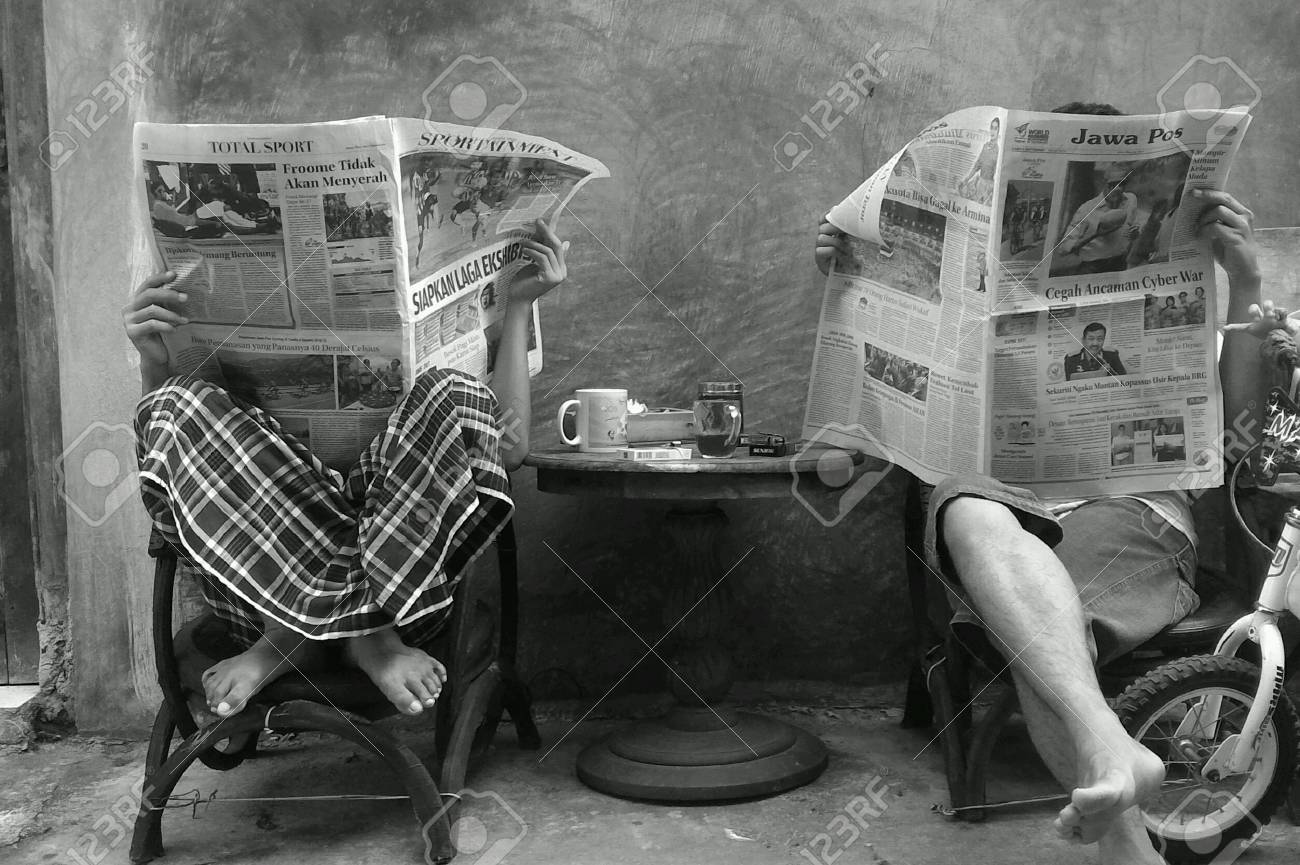 people reading newspaper stock photo, picture and royalty free image