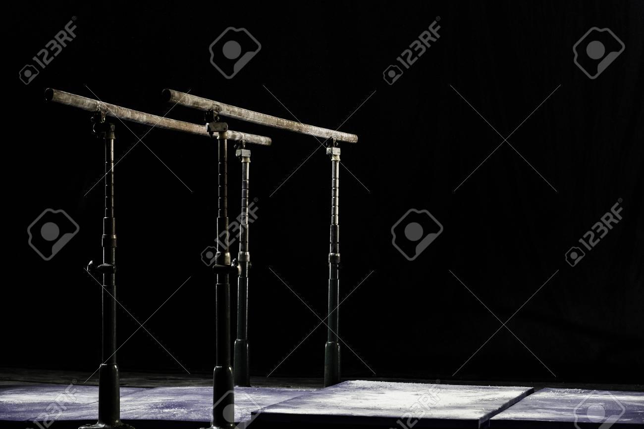 Closeup. Talcium powder over gymnastic parallel bars. Gymnastic parallel bars. Isolated on black background, Banque d'images - 79003830