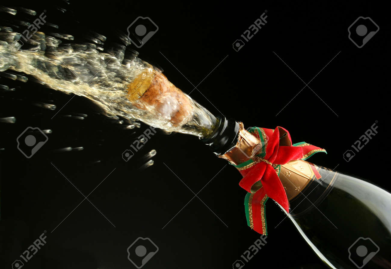 Champagne splash. Bottle and cork, with christmas decoration Stock Photo - 597346