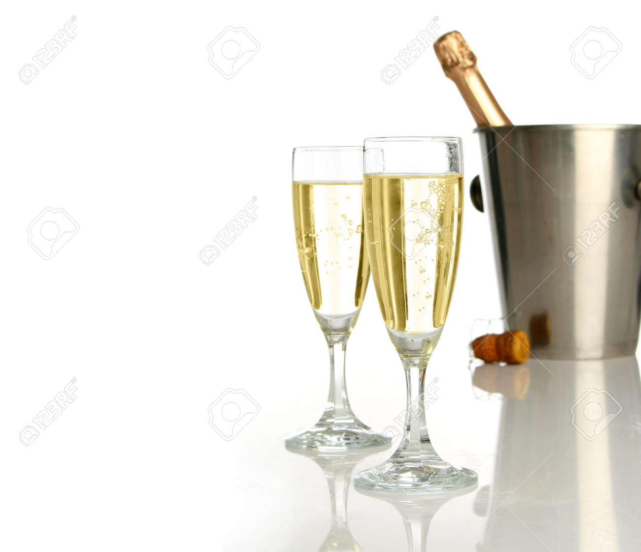 Champagne flutes and ice bucket, festive combo. Stock Photo - 604395