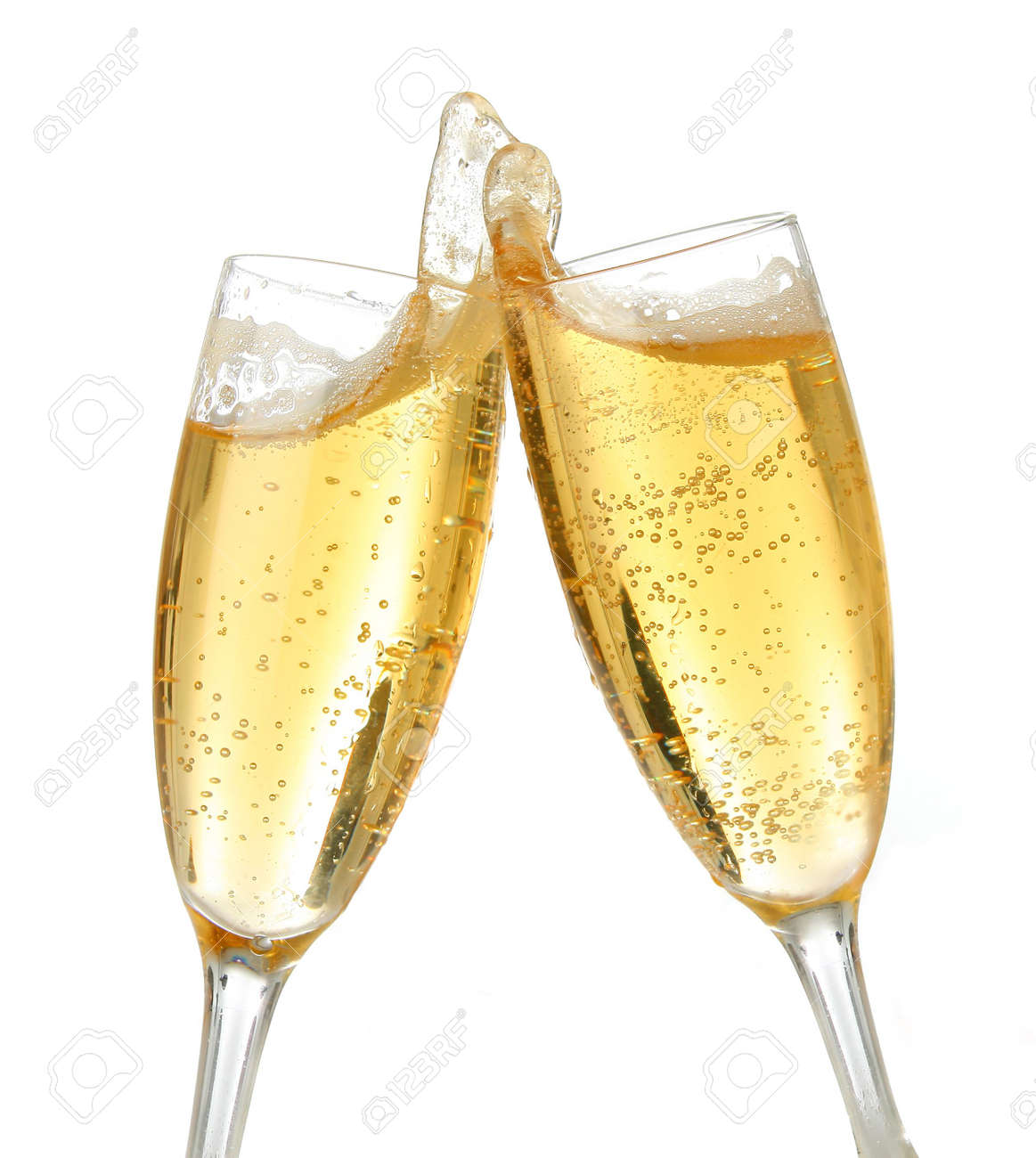 pair of champagne flutes making a toast champagne splash stock