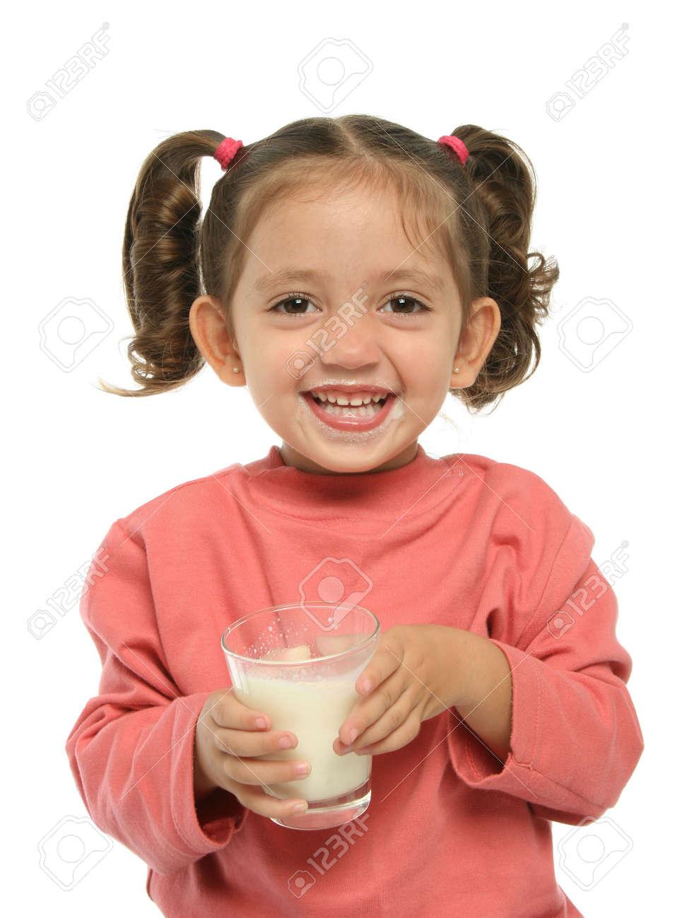 Toddler enjoying a glass of fresh milk Stock Photo - 838549