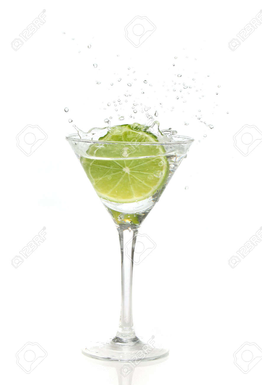 Green lime splashing into a martini glass Stock Photo - 940835