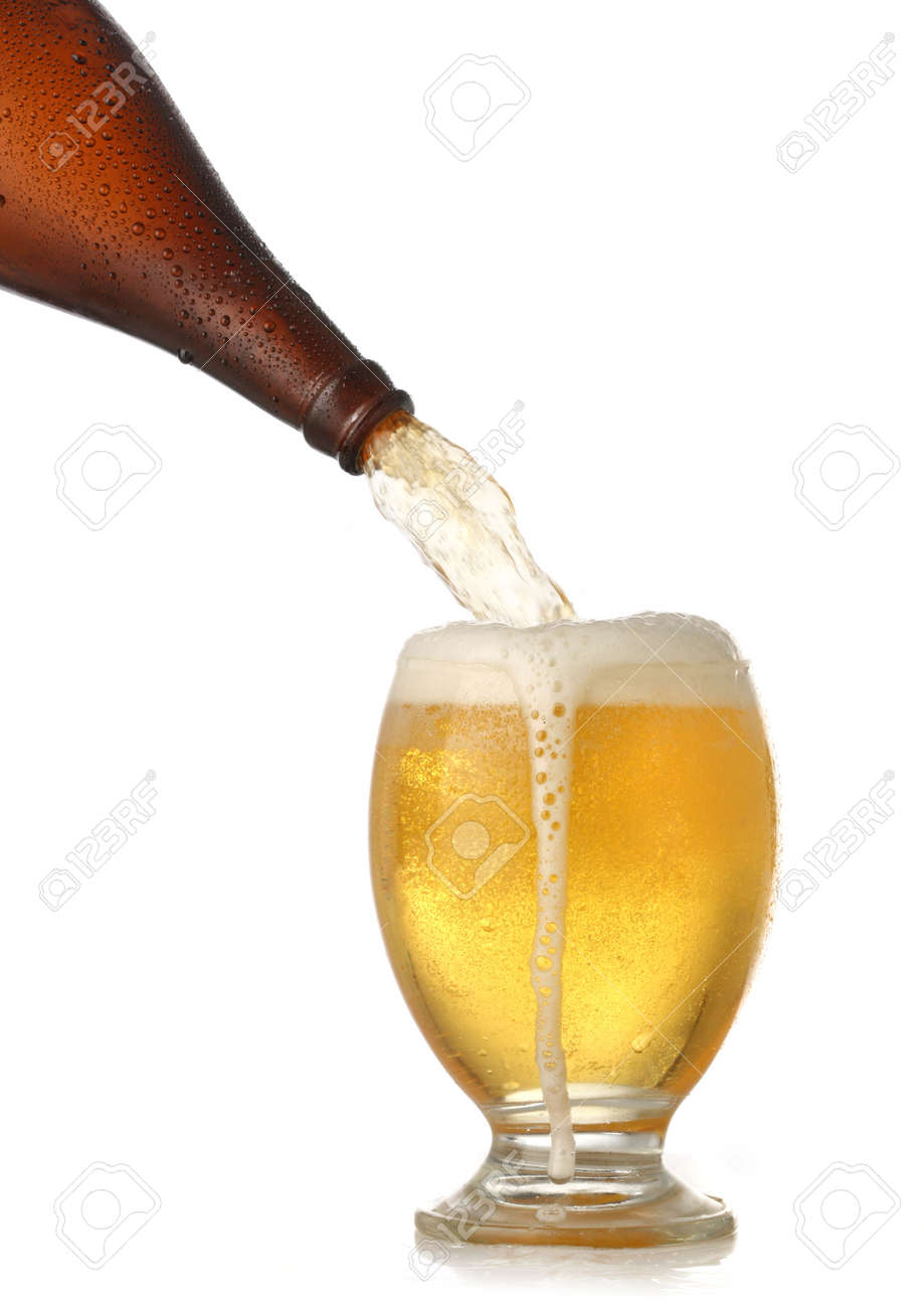 Pouring cold beer into glass isolated on white Stock Photo - 4956153