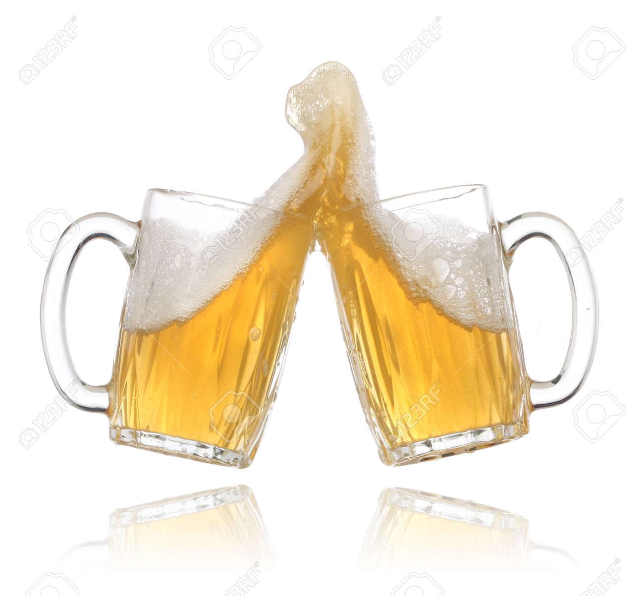 Pair of beer glasses making a toast. Beer splash Stock Photo - 4956144