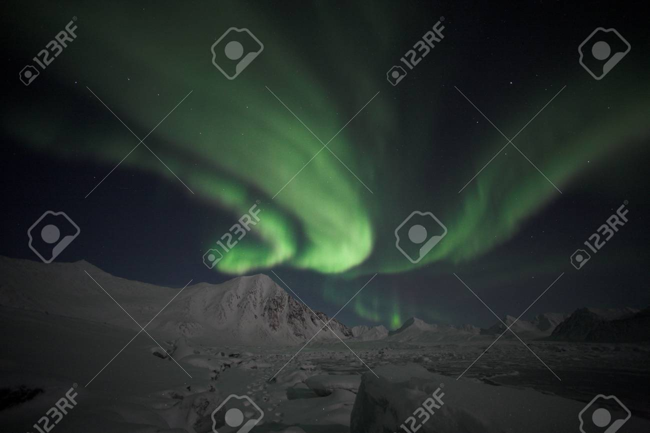 Northern Lights over the Arctic mountains Stock Photo - 16900541