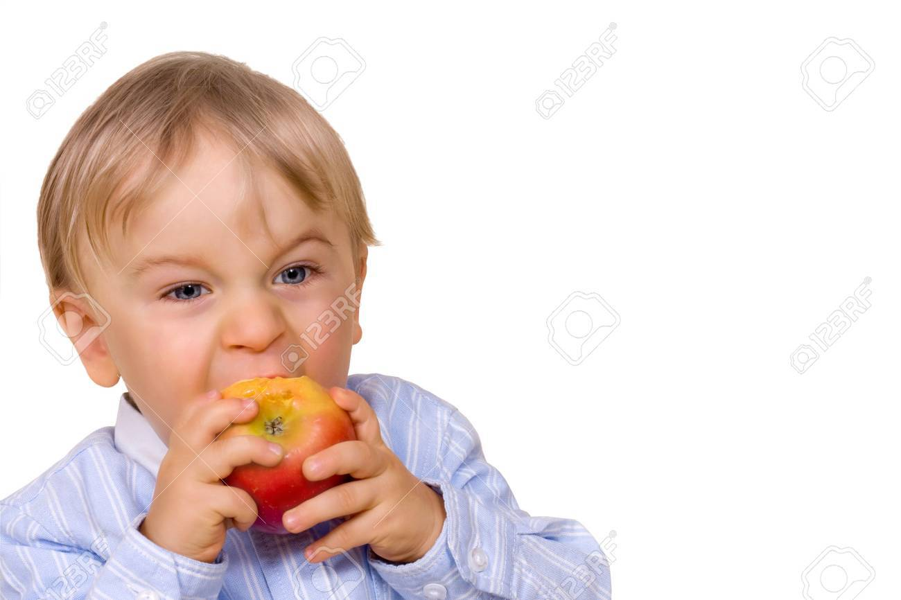 Young boy eating apple Stock Photo - 5889933