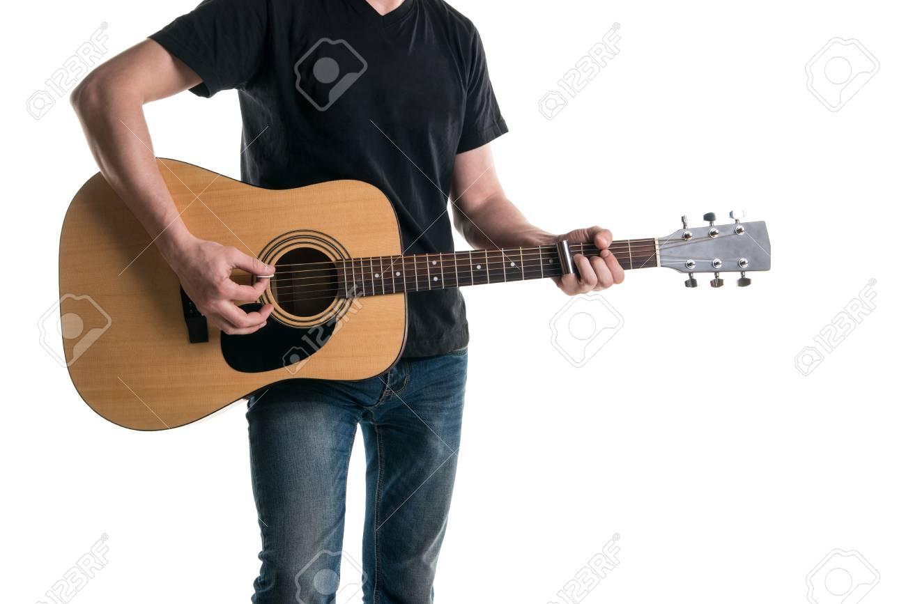 Guitarrista En Jeans Y Una Camiseta Negra, Tocando Una Guitarra ...