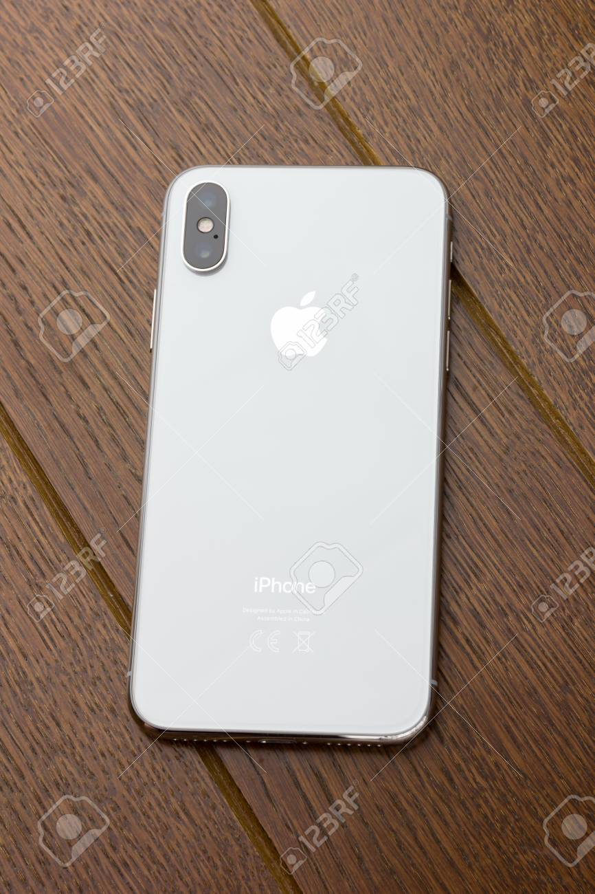 February 2018 Iphone X Lies On A Wooden Table A New Smartphone