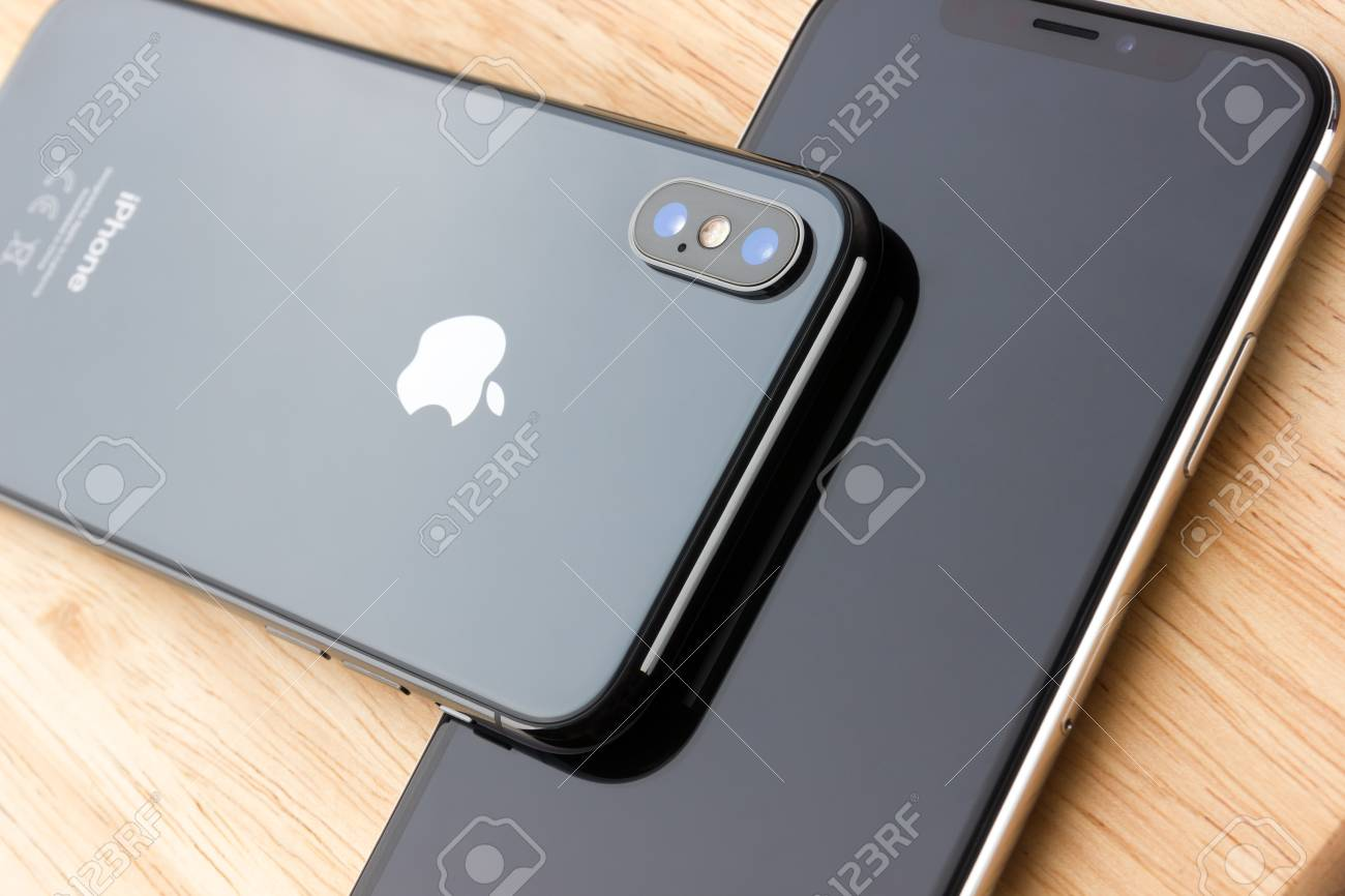 February 2018 Two Iphone X Lies On A Wooden Table A New Smartphones