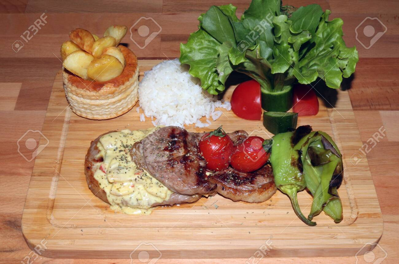 Portion of Delicious Steak With Rice and Vegetables - 146047781