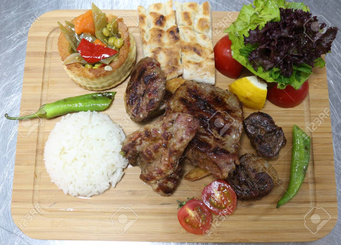 Portion of Delicious Grilled Meat With Rice and Vegetables - 146047784