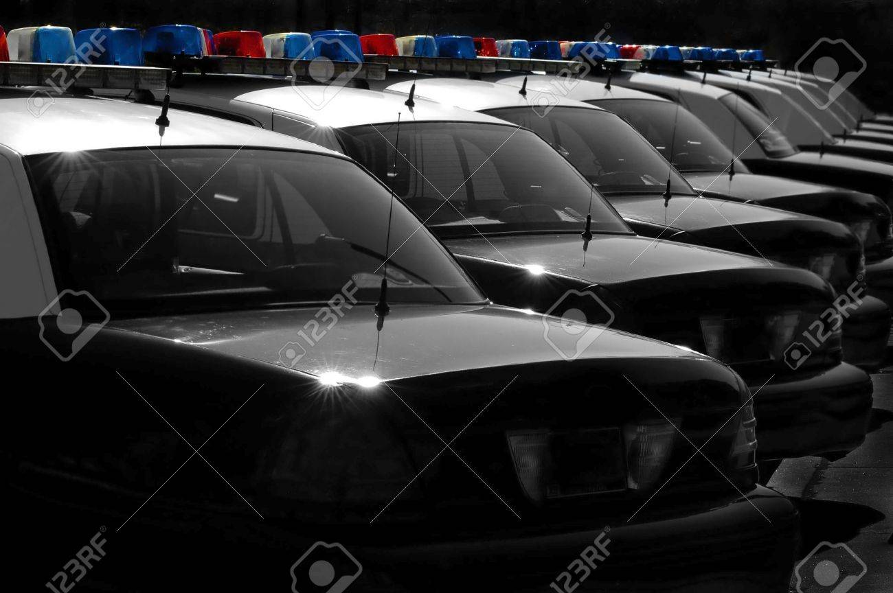 Row of Police Cars with Blue and Red Lights Stock Photo - 1254000