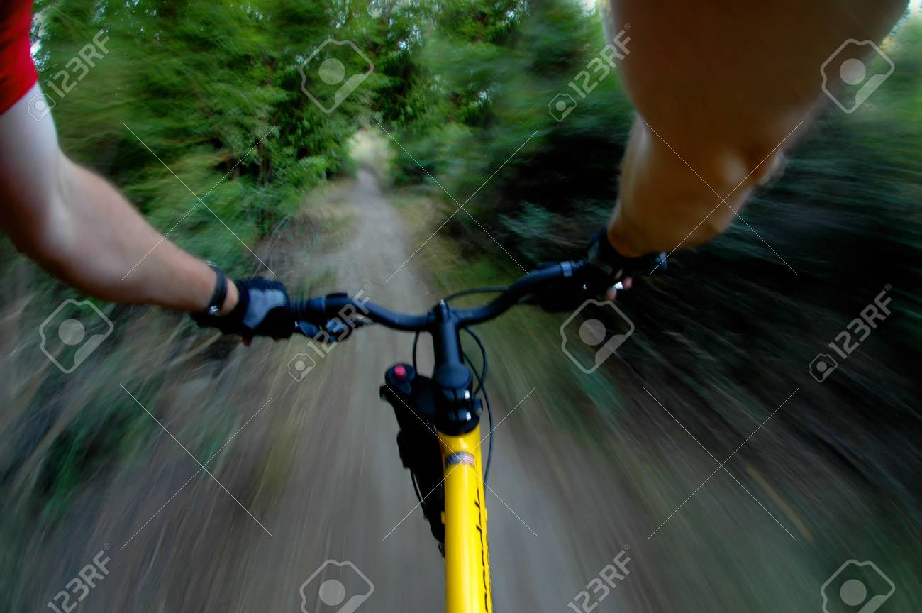 Mountain biking up a trail in the mountains Stock Photo - 1576192