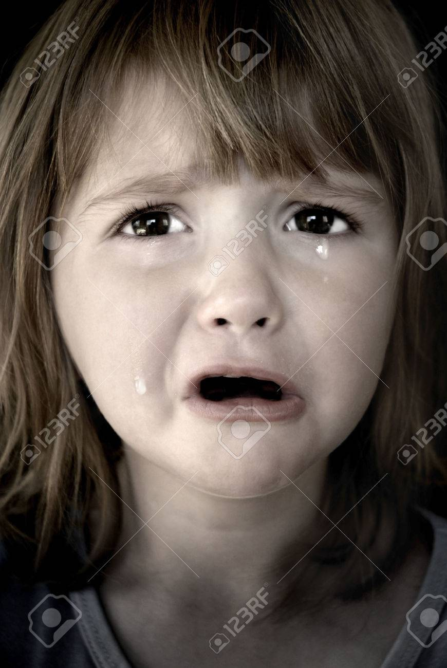 Portrait of little girl crying with tears rolling down her cheeks Stock Photo - 1675191