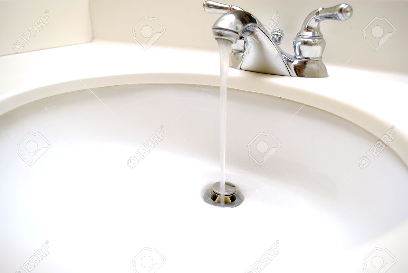 Stock Photo   Water Coming Out Of Spout In Bathroom Sink And Going Down The  Drain