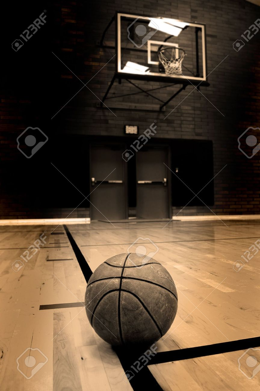Basketball On Court With Hoop In The Background Stock Photo ...