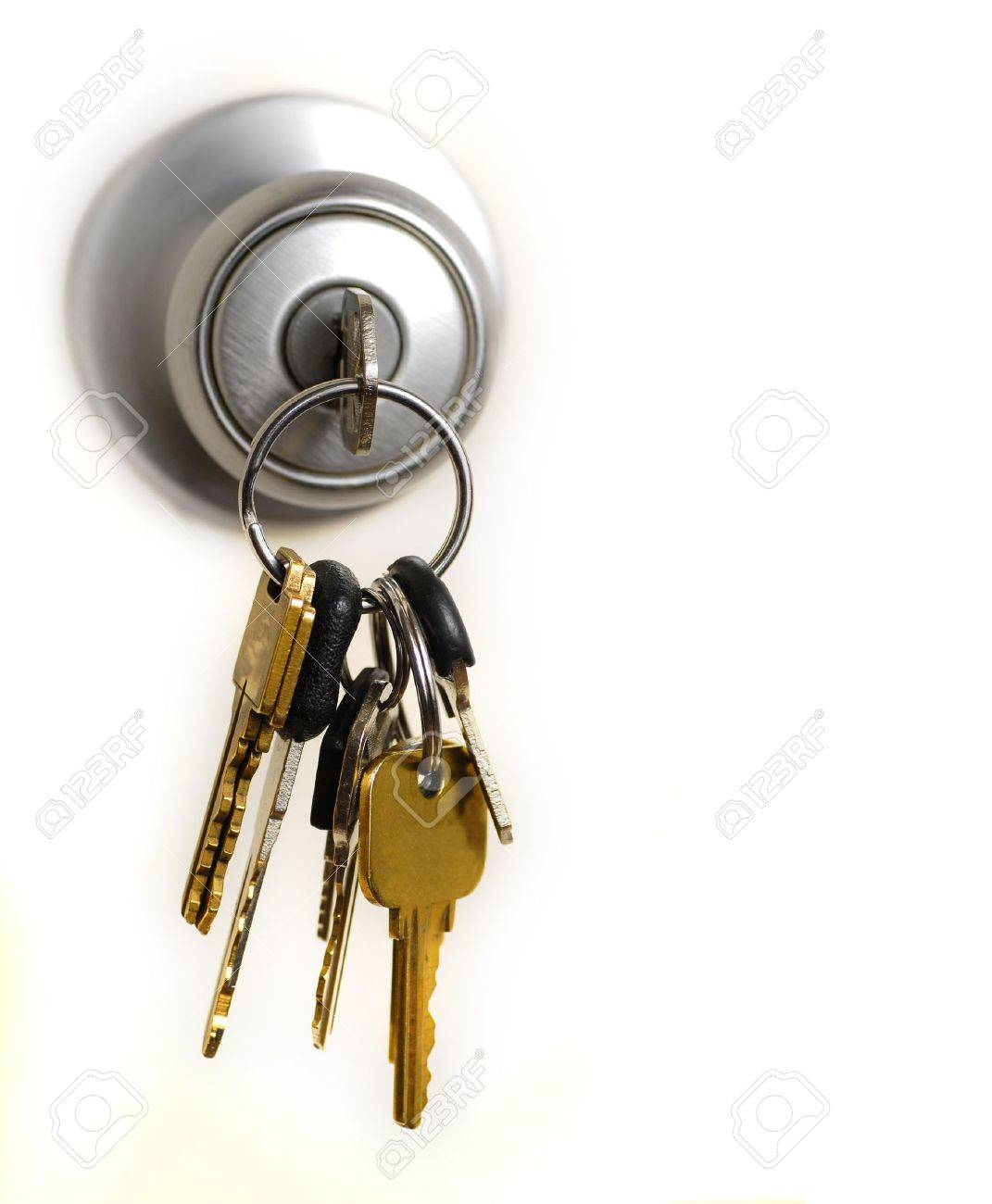 Keys In Lock Hanging From Door Knob Stock Photo Picture And