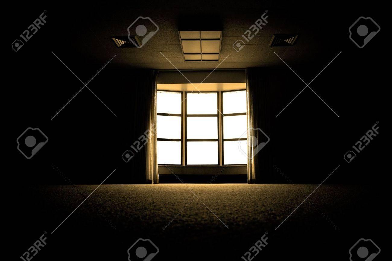 Dark room with light through window - Large Dark Room With Bright Light Coming In Through Paned Window Stock Photo 4246773