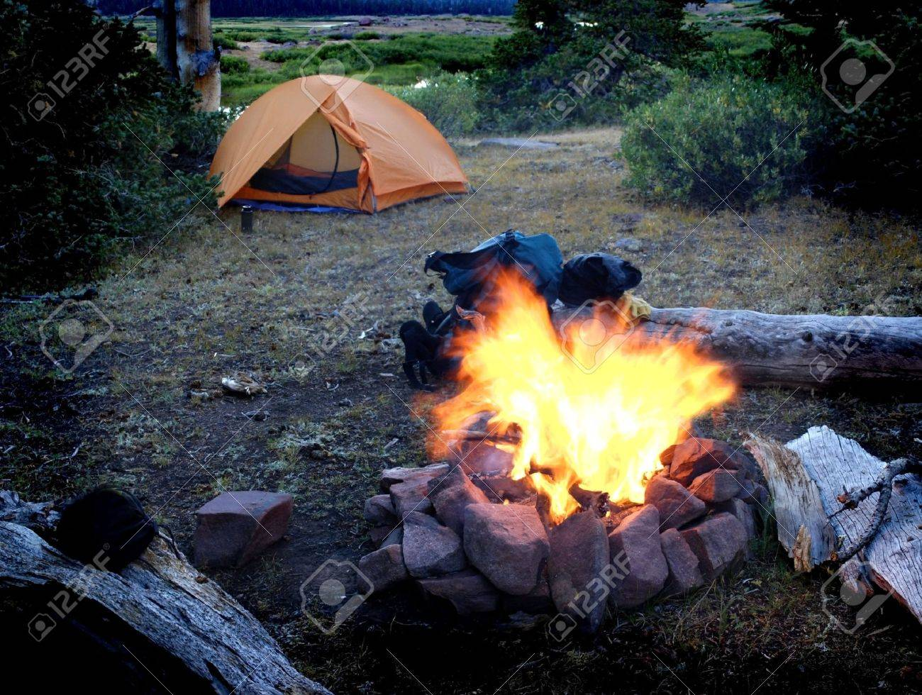 Campfire with tent in background for camping scene Stock Photo - 4539931