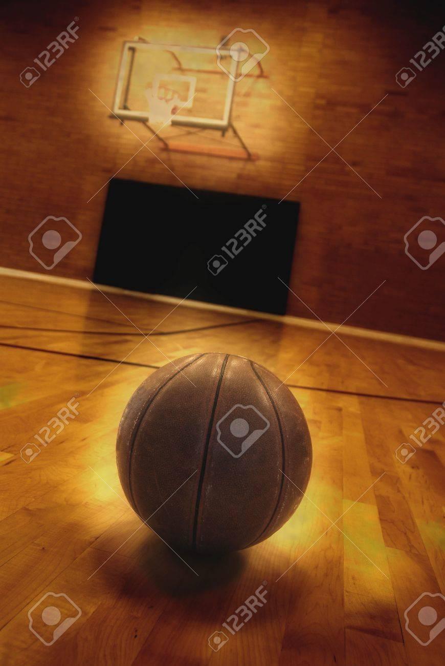 Basketball on floor of empty basketball court Stock Photo - 7747688