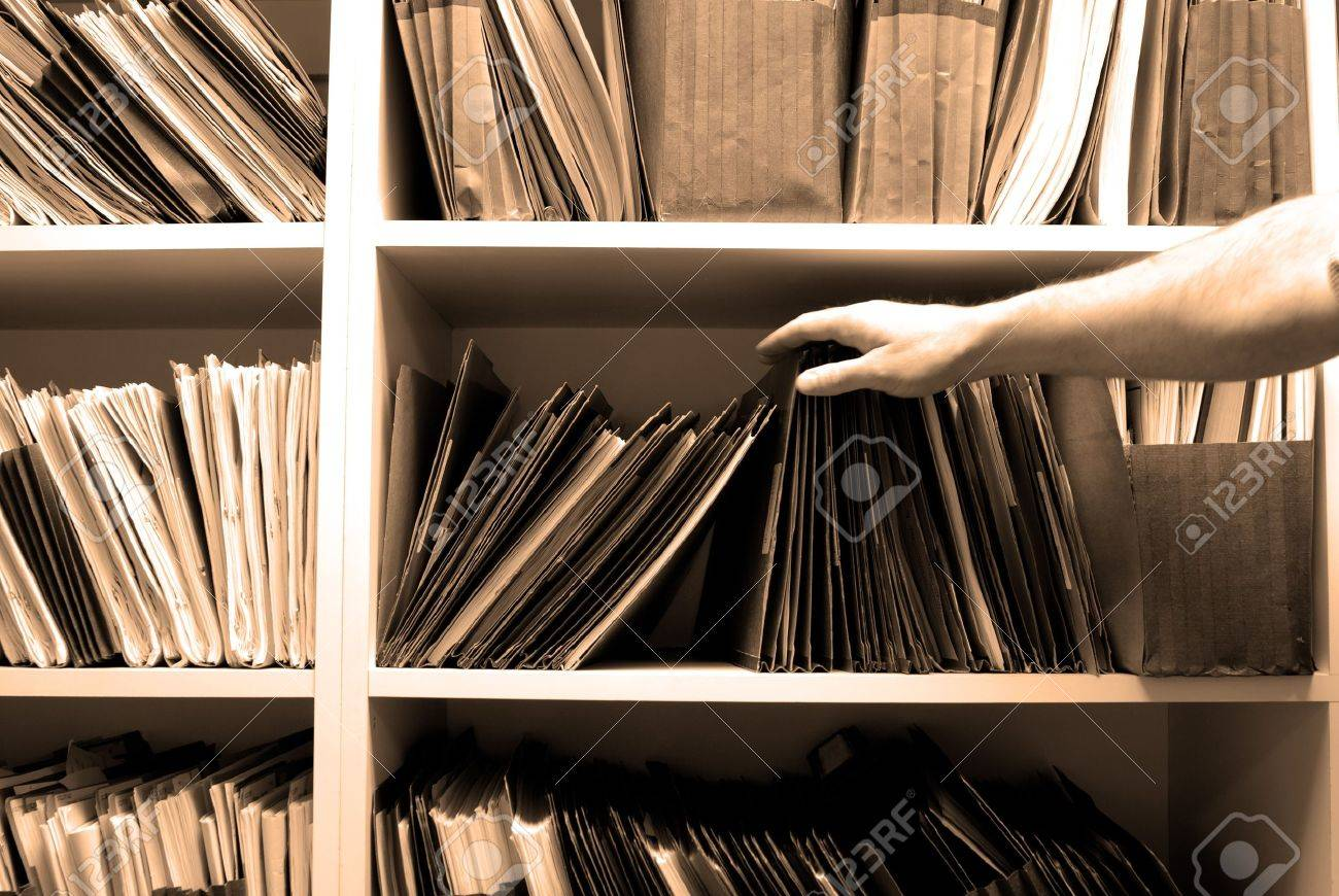 Man reaching for files on shelf in a file room Stock Photo - 9014906