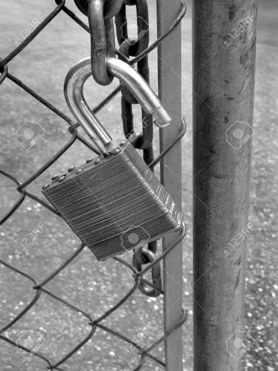 Lock and chain on fence gate illustrating security Stock Photo - 11030744
