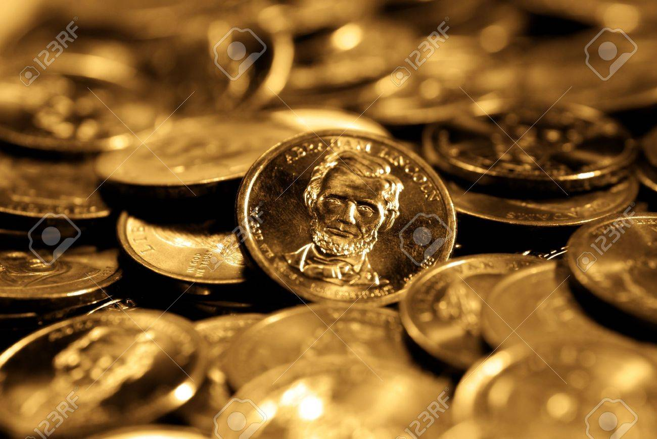 A pile of golden goins representing wealth and savings Stock Photo - 11596735