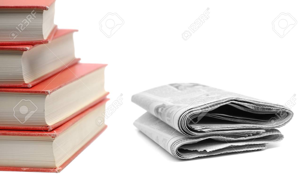 stack of red books and newspapers isolated on white background stock