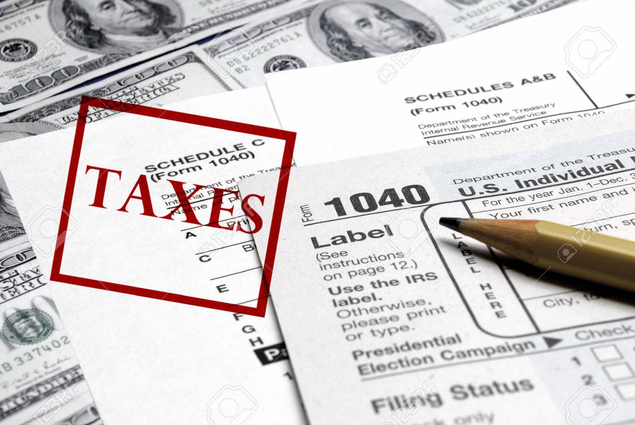 Detail closeup of current tax forms and pencil on money Stock Photo - 25113068