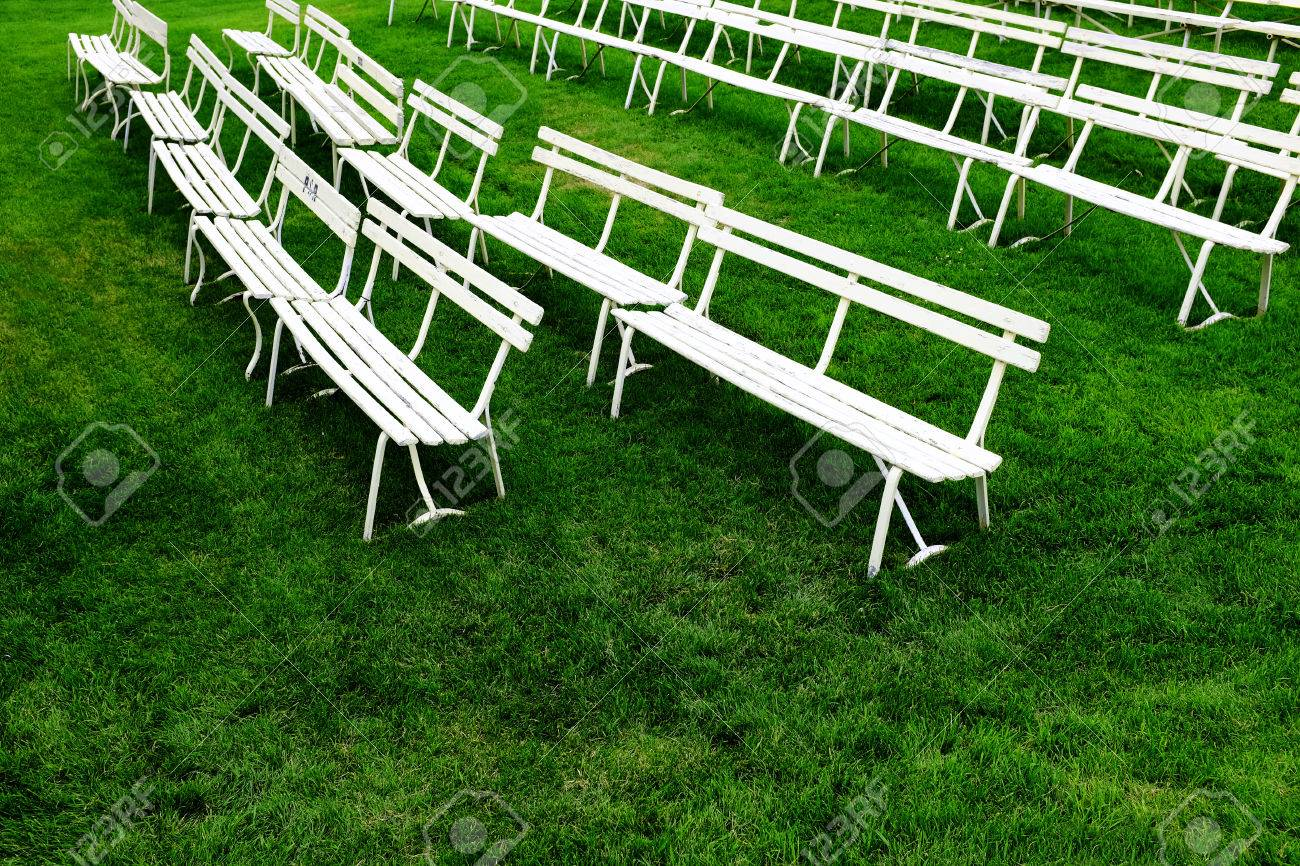 Terrific Rows Of White Park Benches For Sitting On Green Grass Alphanode Cool Chair Designs And Ideas Alphanodeonline