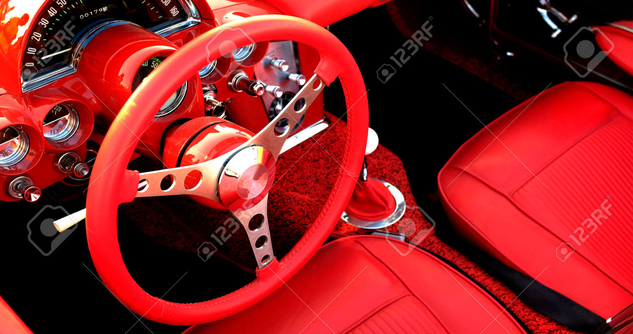 Detail of interior red sports car steering wheel speedometer - 157051611