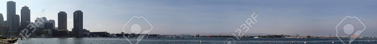 Boston Harbor Panoramic featuring buildings, boats, and shoreline on a summers day Stock Photo - 17091617