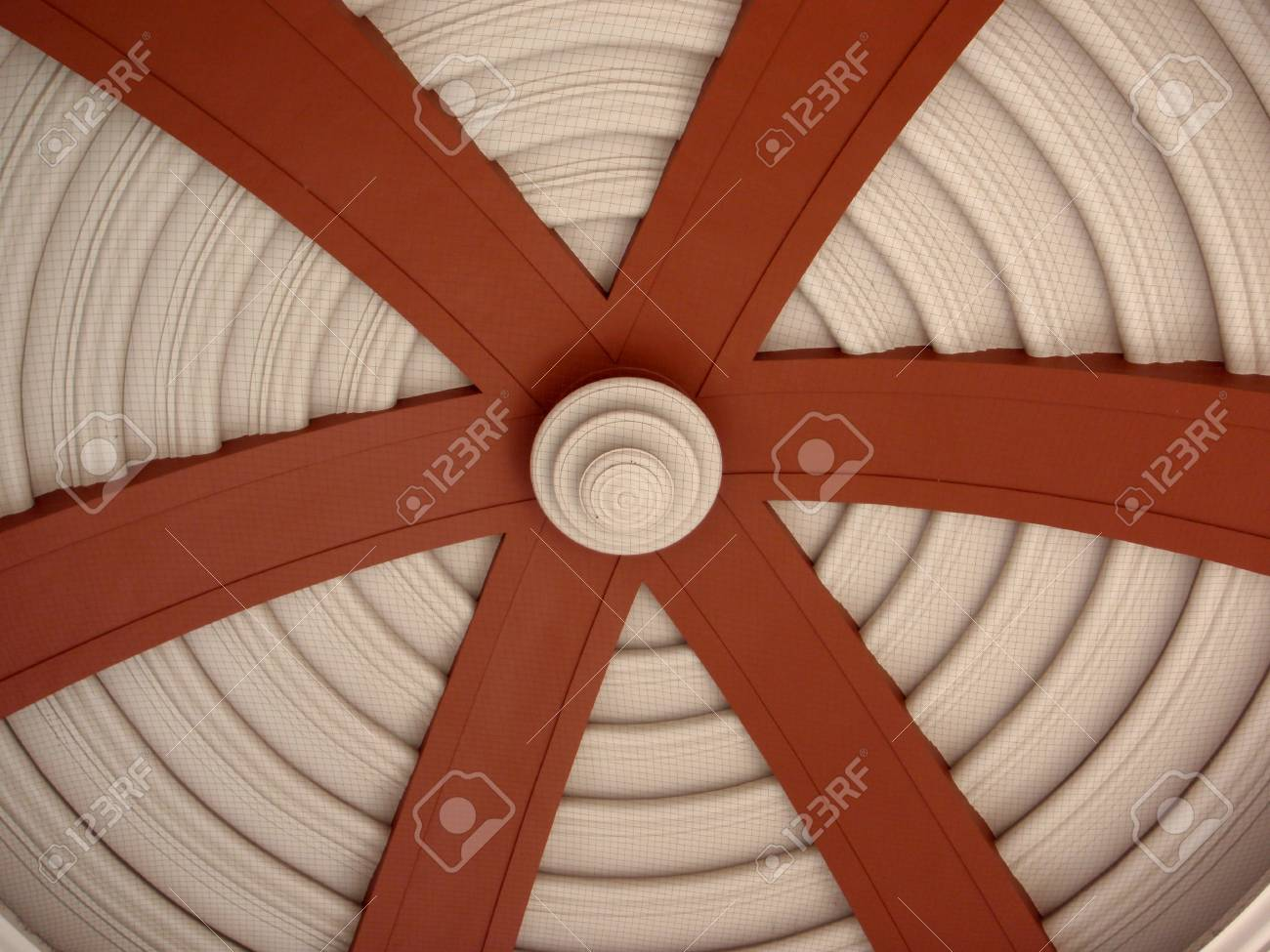 Underside of Dome with circle pattern and large red arches leading towards center with netting to protect from birds   In San Jose, Costa Rica Stock Photo - 18153356
