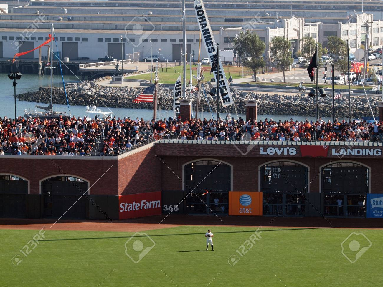 SAN FRANCISCO, CA - OCTOBER 19: Giants vs. Phillies: Giants Right Fielder stands in position with packed bleacher section with Giants fans and McCovey Cove during game 3 NLCS 2010 October 19, 2010 AT&T Park San Francisco California. Stock Photo - 19075530