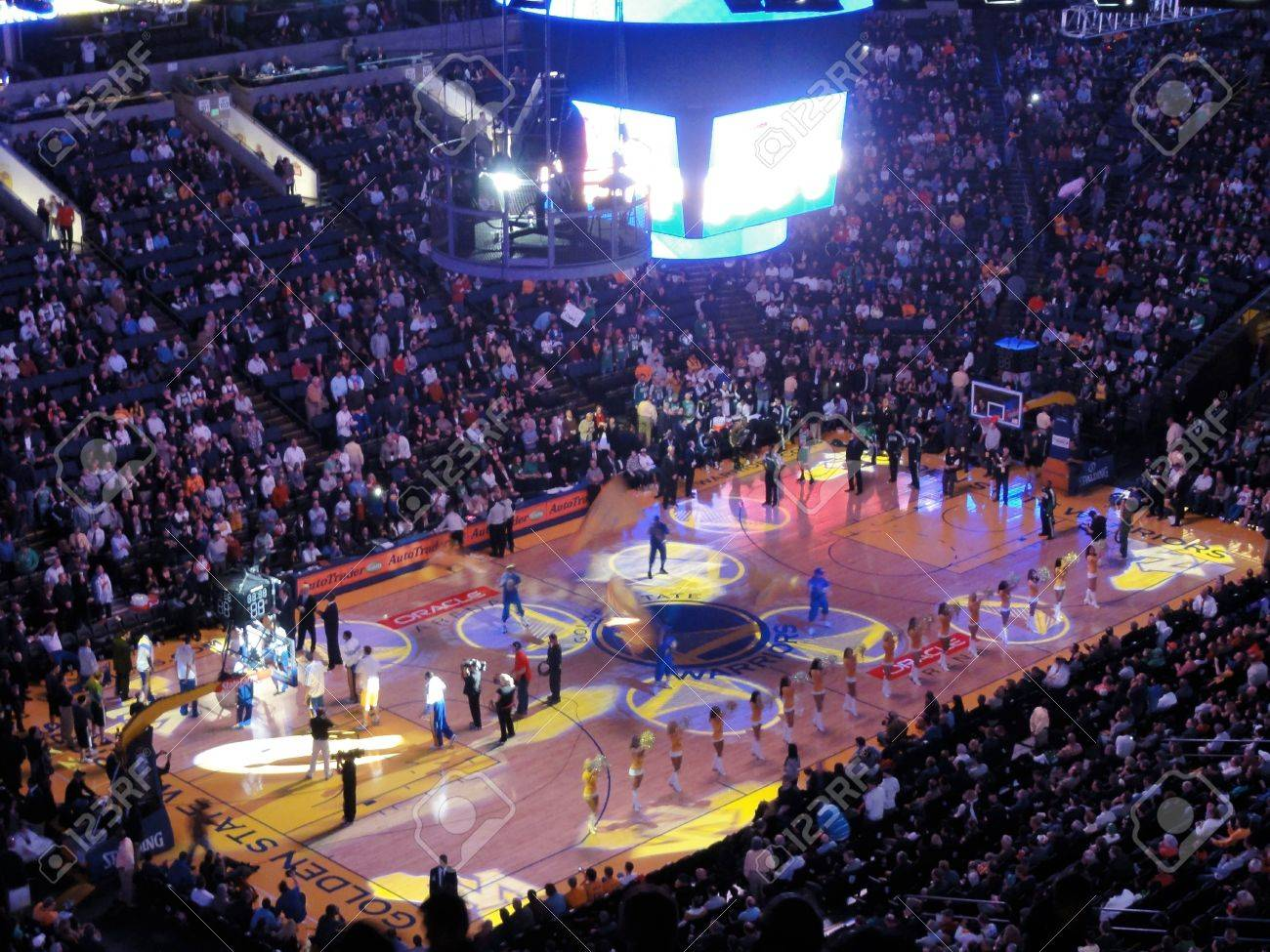 OAKLAND, CA - FEBRUARY 22: Light show goes on during Golden State Warriors intro to game as cheerleaders pump up crowd. Taken February 22, 2011 Oracle Arena Oakland, CA. - 19921102