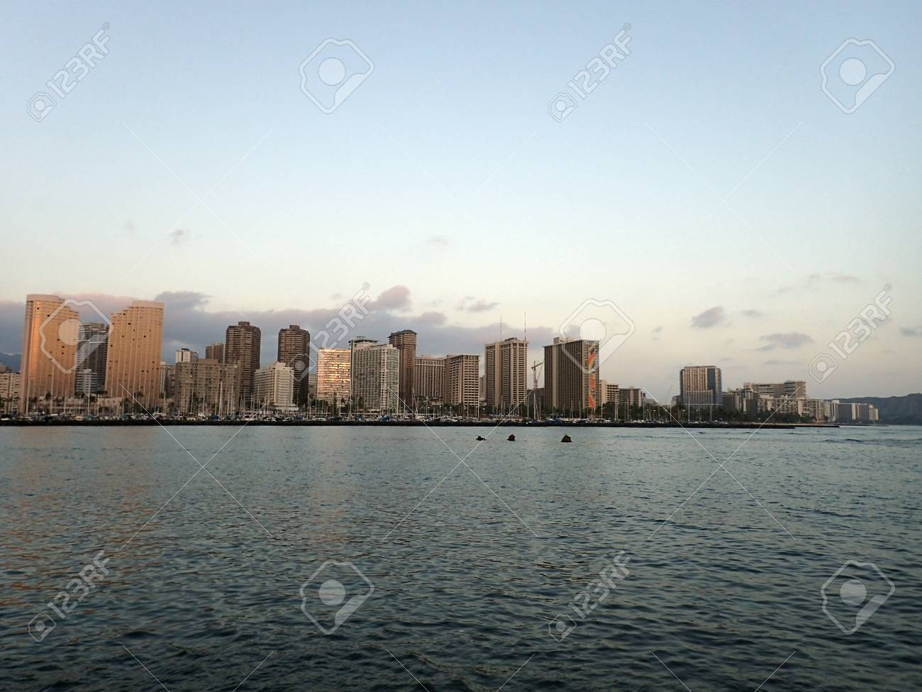 Skyline Of Waikiki At Sunset Or Dusk With Yachts And Boats In ...