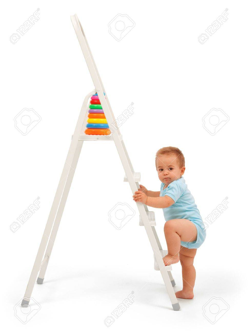 serious baby boy wants to reach the target walk up the ladder serious baby boy wants to reach the target walk up the ladder and get the