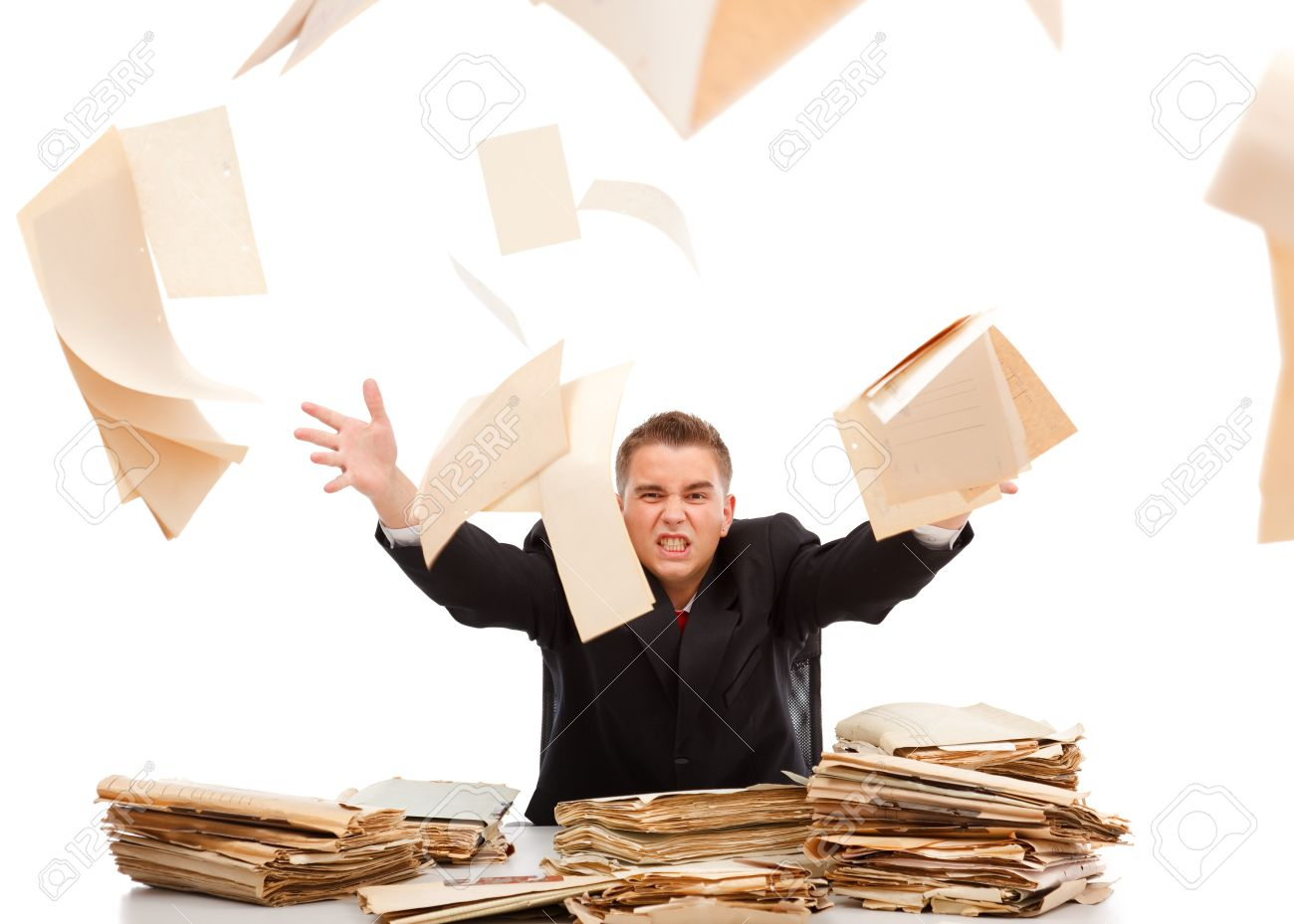 Angry business man throwing away lots of paperwork Stock Photo - 7872947