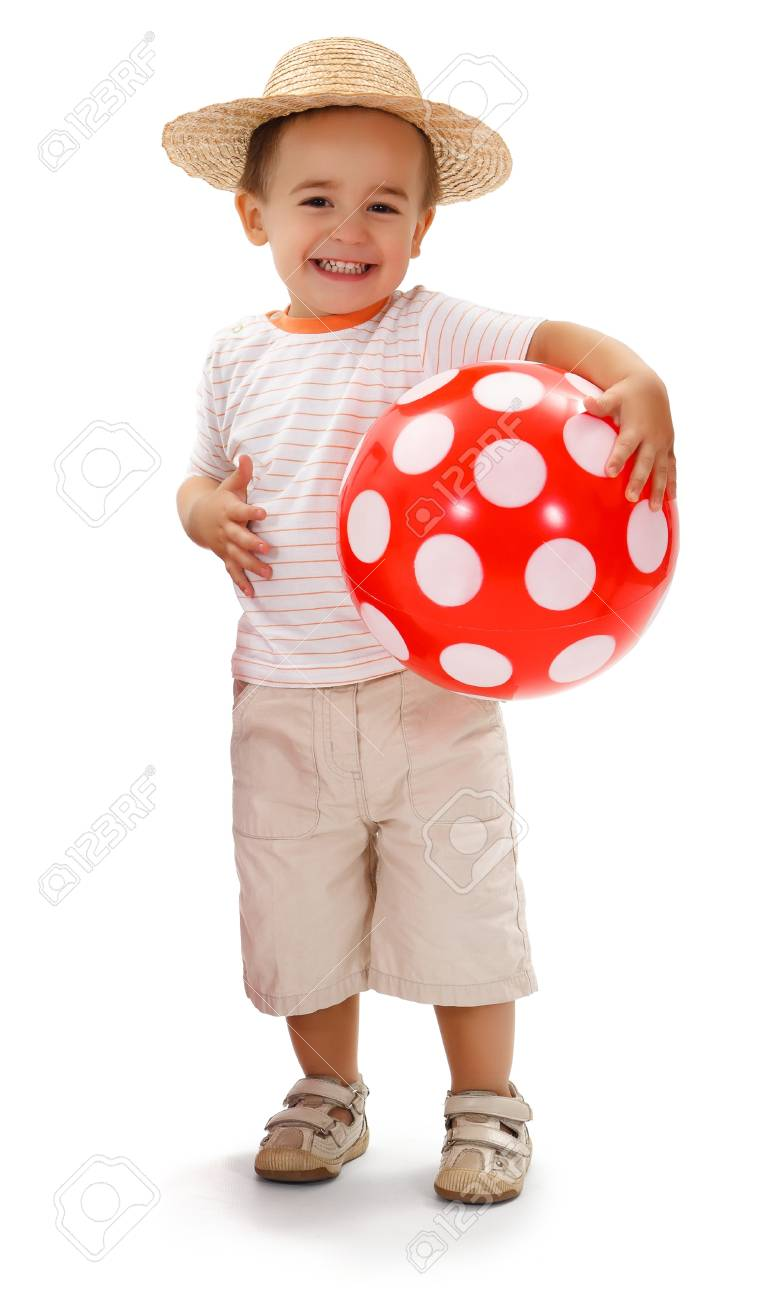 Cheerful little boy in straw hat, holding big red dotted ball Stock Photo - 10306743