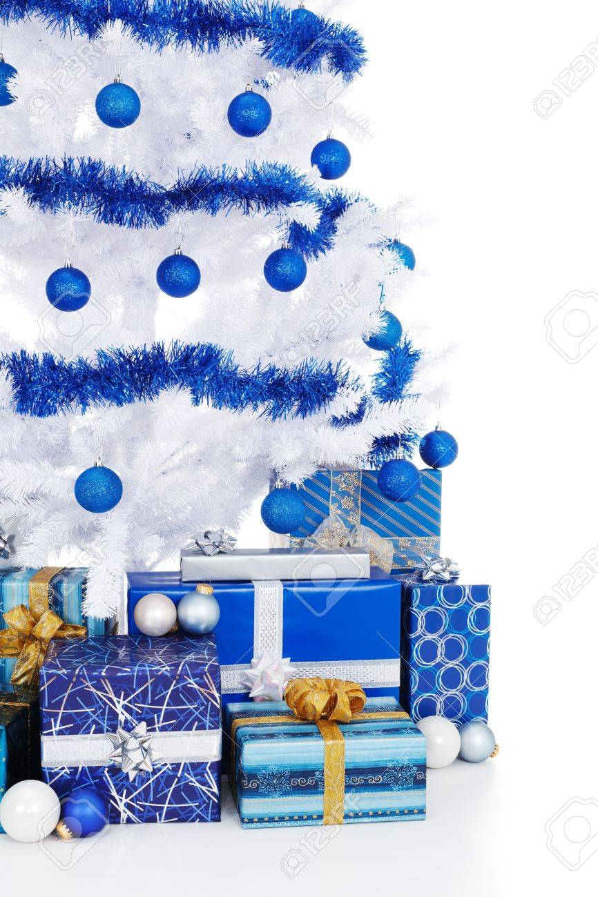 White christmas tree with blue decorations - Cropped View Of An Artificial White Christmas Tree Decorated In Blue Lots Of Presents