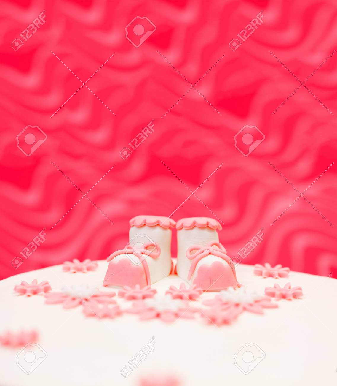 Closeup view of pink topper and flower decoration on baptist cake. Copy space above Stock Photo - 15863087
