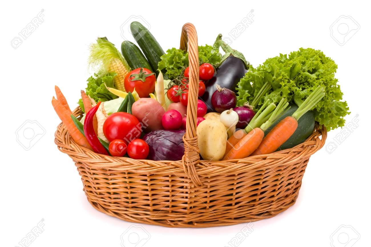 Stock Photo   Wicker Basket Full With Various Fresh Vegetables On White