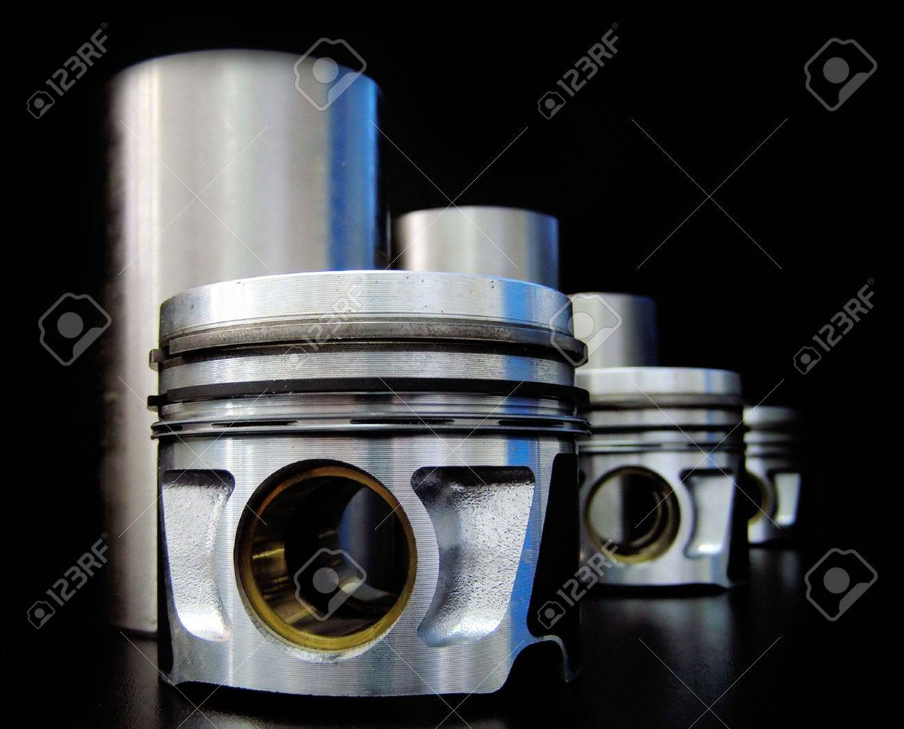 Set of pistons and liners isolated on black Stock Photo - 3070075