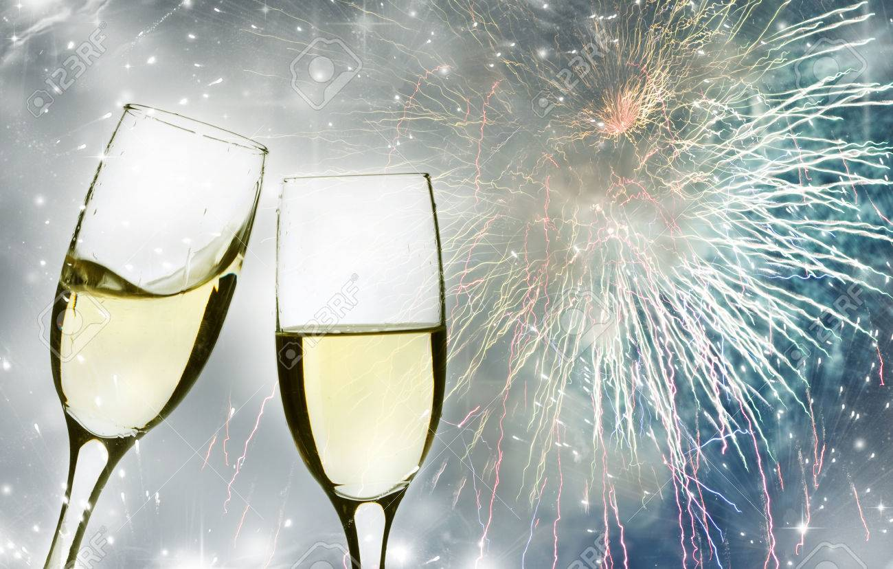 Glasses with champagne against fireworks and clock close to midnight Stock Photo - 23846635