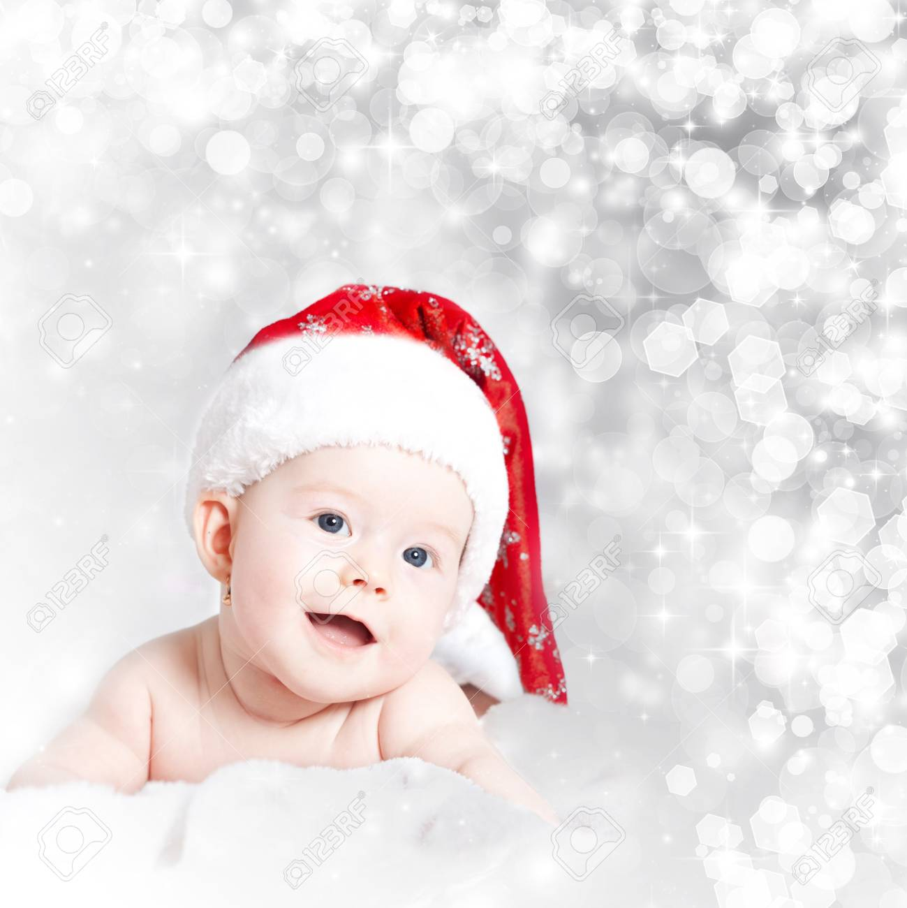 047327fc9 Portrait of a baby with Santa hat isolated on holiday